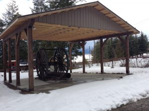 Logging arch in its protective new shed, Creston Museum, Creston BC