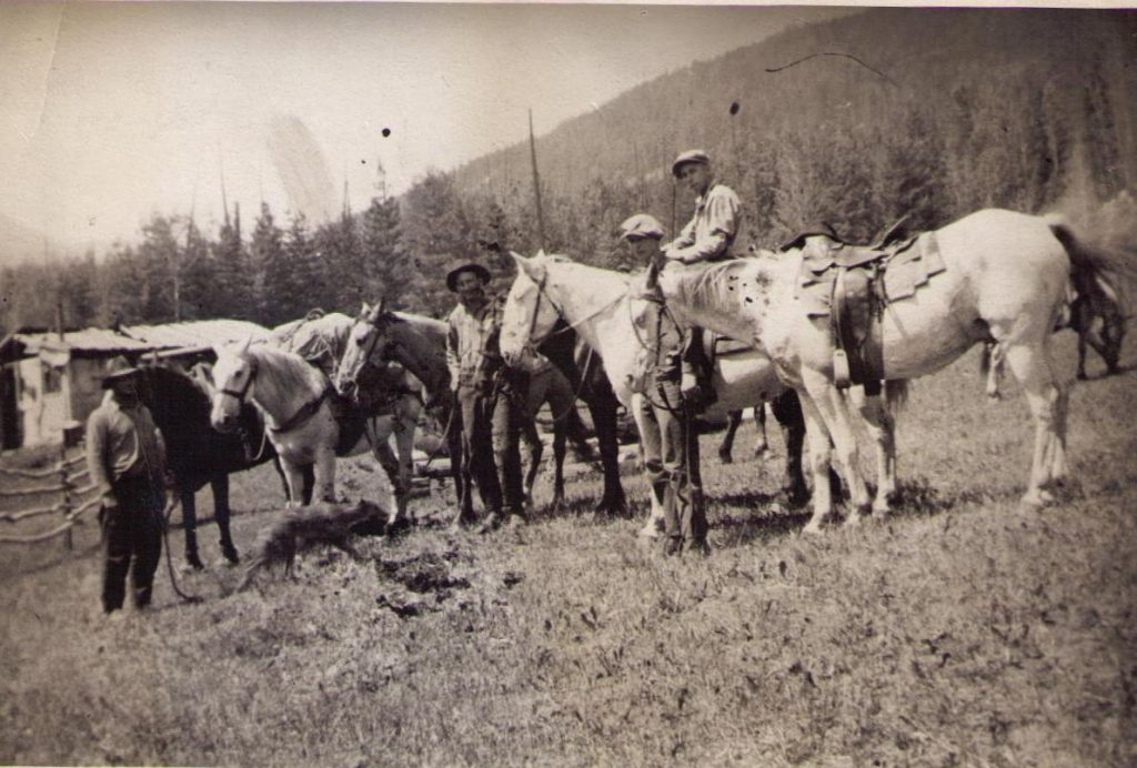John Blinco, on horseback, and others at Jordan's Cabin, date unknown